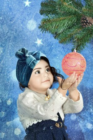 Little girl with christmas ball
