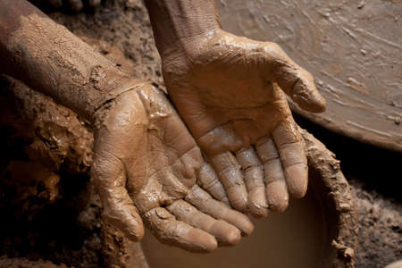 A image with top view showing the hands of a craftsman