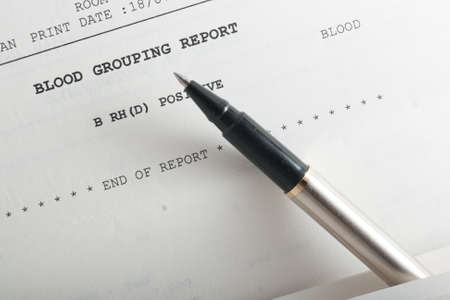 Closeup of blood grouping medical report details. Archivio Fotografico