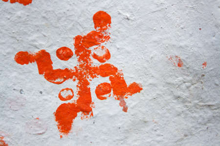 The symbol  on a white wall. is a geometrical figure and an ancient religious icon in the cultures of Eurasia. It is used as a symbol of divinity and spirituality in Indian religions.