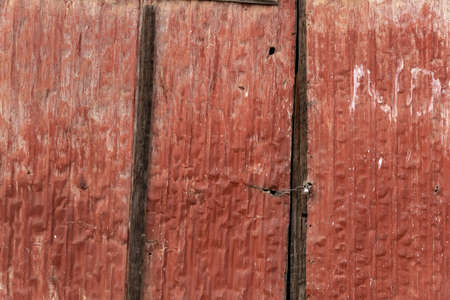 Closeup of red brown painted metal door