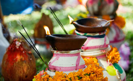 Photograph of lamps & pots used in typical worship in Indian culture. Editoriali