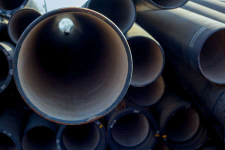 Closeup of big water pipes background.