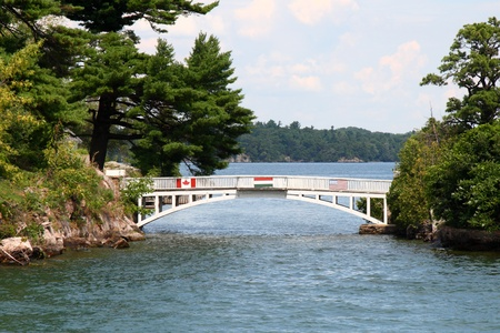 shortest international bridge in the world between canada and united states in 1000 islands Фото со стока
