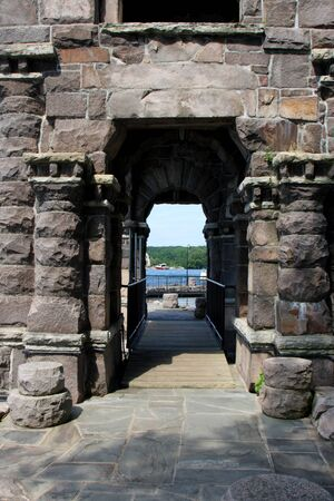 old stone archway at boldt castle grounds photo