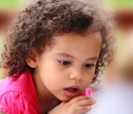 multi racial little girl with surprised expression