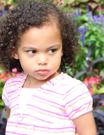 biracial: a cute little girl that is pouting
