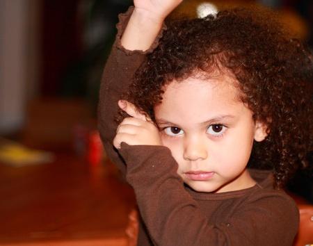 cute little girl posing the cha cha photo