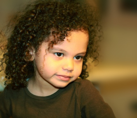 a cute little mixed race child portrait look of innocence photo