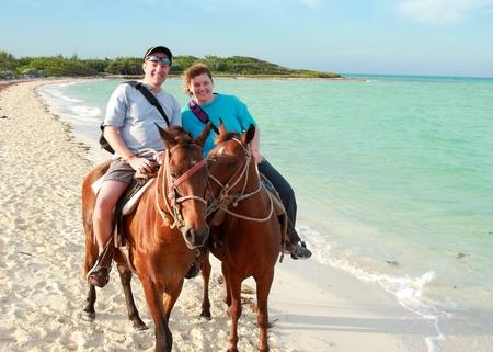 horseback riding: romantic horseback riding on ocean beach