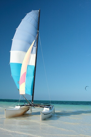 sailboat catamaran on tropical beach photo
