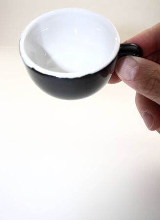 taking a sip of coffee