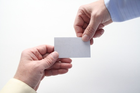 one handing out a business card to someone else