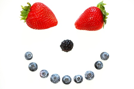 a smiley face in the form of various berries Standard-Bild