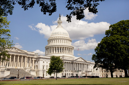 federal government: WASHINGTON D.C. - MAY 23 2014: The United States Capitol is the meeting place of the United States Congress, the legislature of the U.S. federal government. Located in Washington, D.C., it sits atop Capitol Hill at the eastern end of the National Mall.  [
