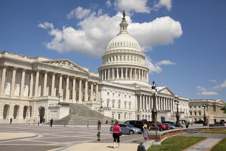 governing: WASHINGTON D.C. - MAY 23 2014: The United States Capitol is the meeting place of the United States Congress, the legislature of the U.S. federal government. Located in Washington, D.C., it sits atop Capitol Hill at the eastern end of the National Mall.