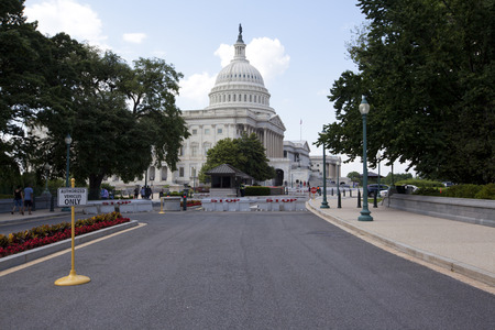 federal government: WASHINGTON D.C. - MAY 23 2014: The United States Capitol is the meeting place of the United States Congress, the legislature of the U.S. federal government. Located in Washington, D.C., it sits atop Capitol Hill at the eastern end of the National Mall.