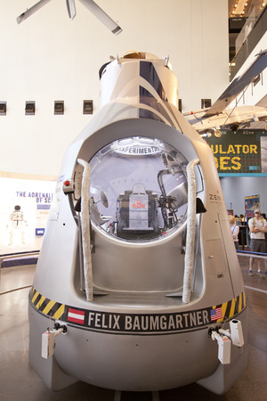 felix: WASHINGTON D.C. - MAY 24, 2014: The Red Bull Stratos capsule that Felix Baumgartner jumped from in the world - record  longest freefall. The capsule  has an exterior shell comprised of insulated fiberglass.