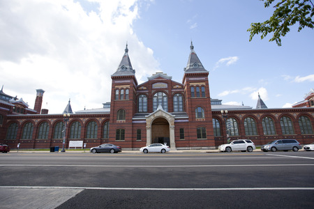 renamed: WASHINGTON D.C. - MAY 24, 2014: The Smithsonian National Museum Building was renamed the Arts and Industries Building in 1910, when the Natural History collection was moved into the new US National Museum across the Mall.The exterior features an ornate po Editorial