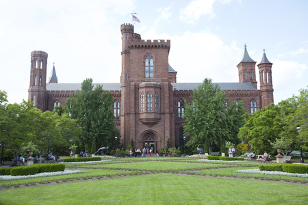 institutions: WASHINGTON D.C. - MAY 24, 2014: The Smithsonian Institution Building, commonly known as the �Castle,� houses the Smithsonian Institution�s administrative offices, as well as the Information Center. It is considered the �anchor� of the National Mall. Editorial