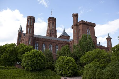 institutions: WASHINGTON D.C. - MAY 24, 2014: The Smithsonian Institution Building, commonly known as the �Castle,� houses the Smithsonian Institution�s administrative offices, as well as the Information Center. It is considered the �anchor� of the National Mall