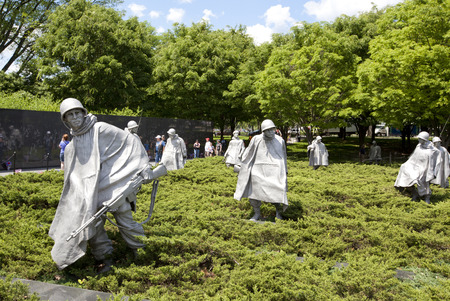 WASHINGTON D.C. - MAY 25 2014: Sculptures at Korean war veterans memorial in Washington DC. The memorial was dedicated July 27, 1995, the 42nd anniversary of the armistice ending the war.