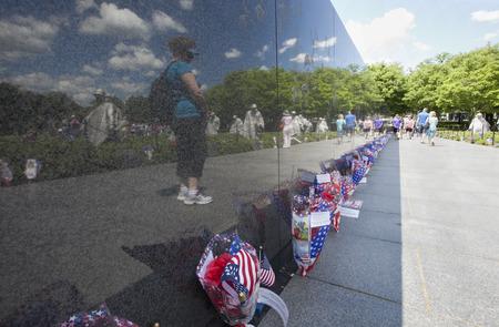WASHINGTON D.C. - MAY 25 2014: Visitors remembering fallen soldiers at the Korean War Memorial at Washington Mall in Washington DC during memorial day weekend. Editorial