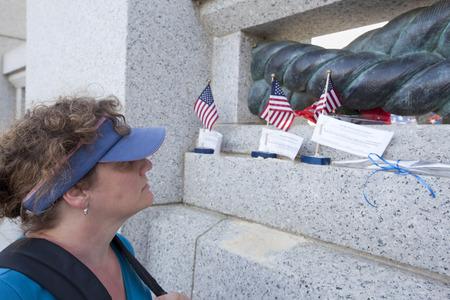 woman looking at memorial for fallen veteran in Washington DC