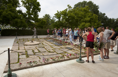 WASHINGTON D.C., MAY 26, 2014: People come to pay their respects and remember John F. Kennedy at his grave in Arlington National Cemetery during Memorial Day weekend.