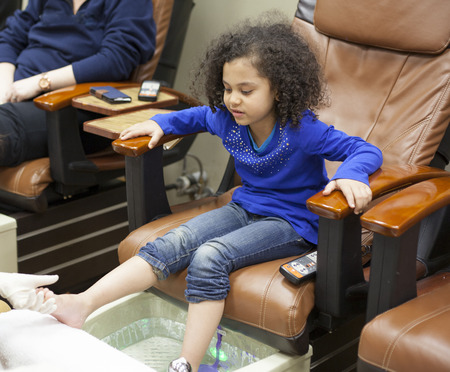 young girl at the beauty spa getting pedicures