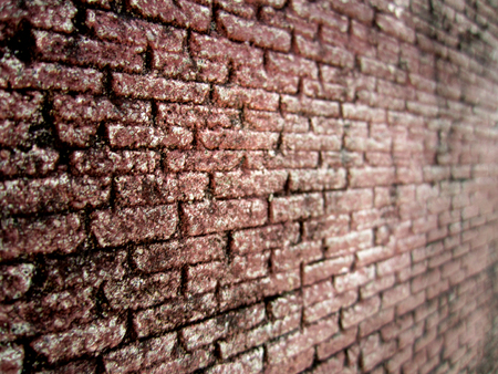overbuilding: Angle view of brick wall background texture in shallow depth of field