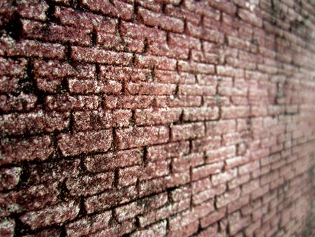 overbuilding: Angolo di vista di sfondo muro di mattoni trama in profondit� di campo
