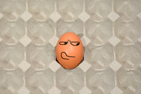 fearful: fearful eggs in paper panel Stock Photo