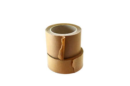 masking tape: two rolls of brown sticky tape on white background. Stock Photo