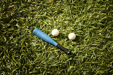 baseball dugout: baseball equipment on lawn, model figure Stock Photo