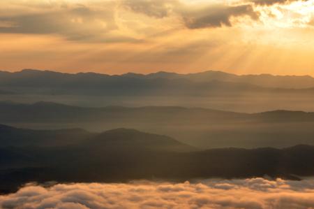 Mountain view landscape with fog at sunrise, Doi Samer Dao, Nan district, Thailand