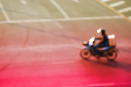 Blur image of car and motor cycle on the road in traffic jam in Bangkok city, Thailand, dreamy color