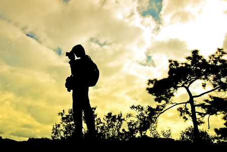 silhouettes photography on mountain, in sunset