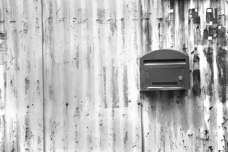black and white ,mailbox with zince tiles wall, letter box with zince tiles wall Archivio Fotografico