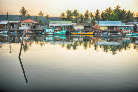 Sunset at fishey village, Floating house and fishery boat on the river in fishery village in Ban Mai Rood, Trat province, Thailand