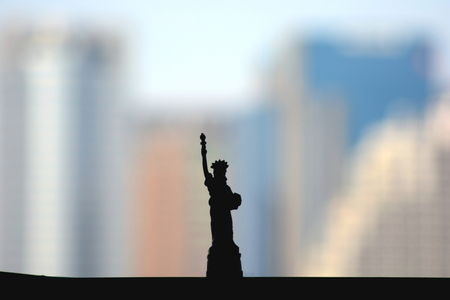 silhouet of Statue of Liberty with building city background, model, set up
