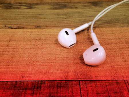 White earphone on the floor, dreamy color Stock fotó