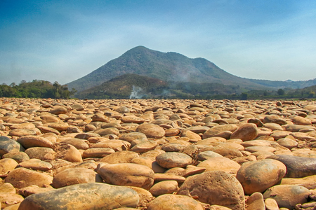 The land is barren scree behind mountain