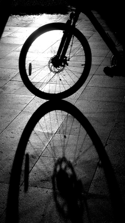 Bike wheel with shadow on ground Stock fotó