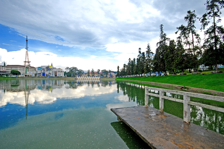 Dalat city with blue sky reflect on the river at the center of city, Vietnam