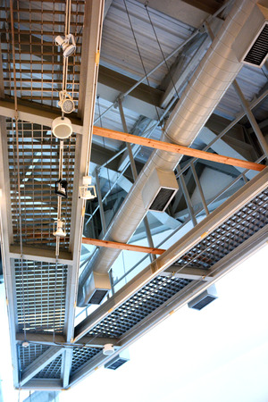 spot light and air tube attached ceiling in the building