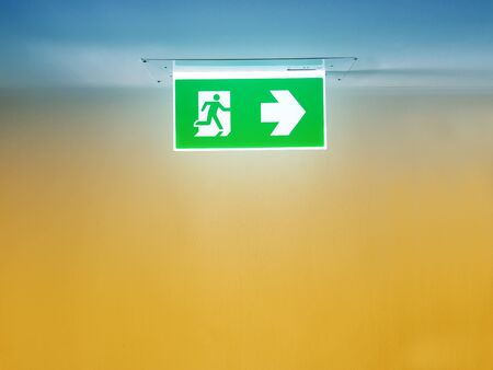 lighted exit sign the way in the building Banque d'images
