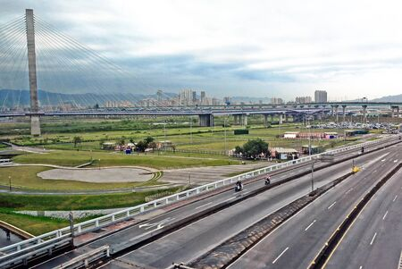 landscape of city with lots of buildings with road on the background