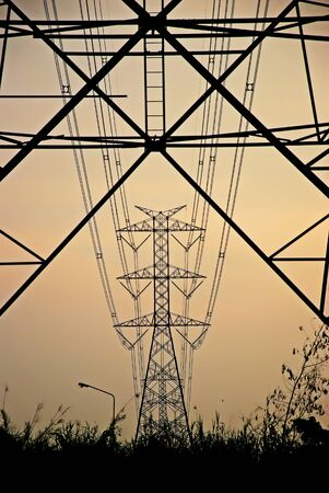 High-voltage tower ,high voltage post , Silhouette of pylons,Electricity pylons and lines, at sky backgound.