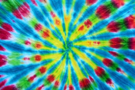 colorful draped tie dyed fabric textile pattern background